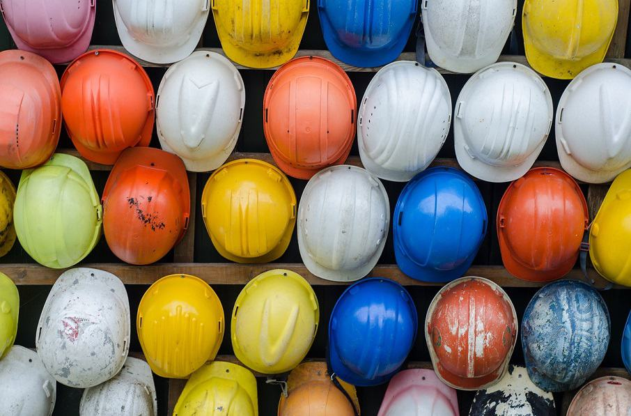 Images of multiple hardhats hanging on the wall