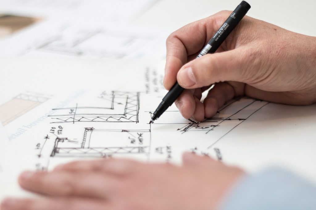 Image of a person drawing a floorplan